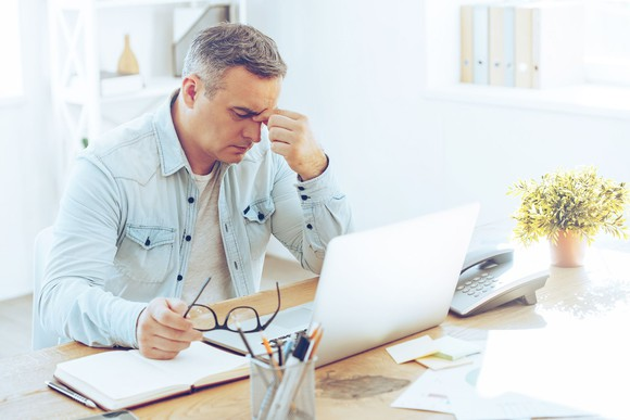 mature-man-frustrated-upset-sitting-in-front-of-computer_large